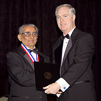 Dr Wani Receiving award from Governer Easley